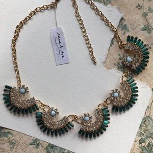 Teal colored Anna & Ava statement necklace .